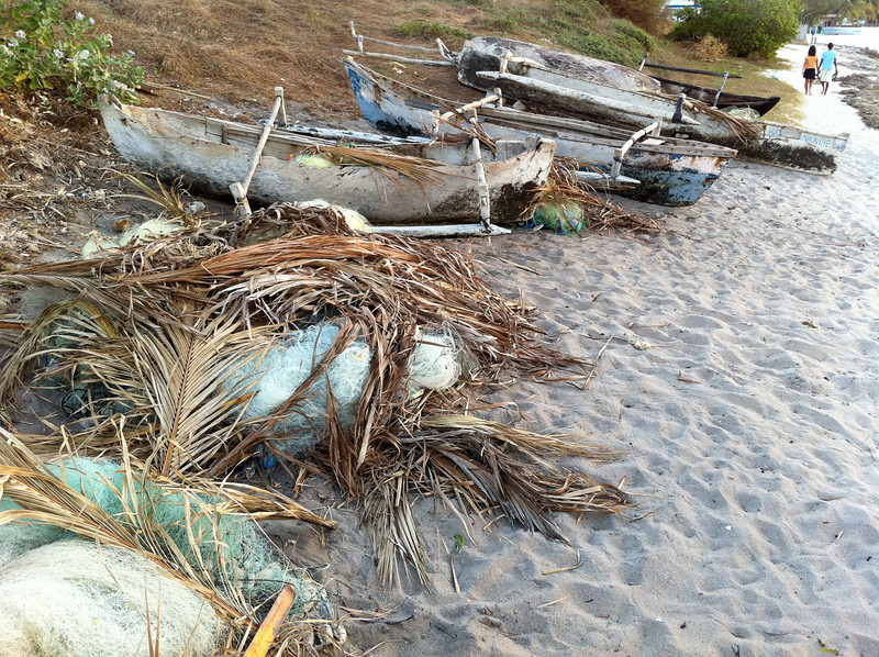 """<span id=""""title"""">Boats and Nets</span> Along the beach there were canoes and nets. I'm not sure why the nets are covered by palm fronds..."""