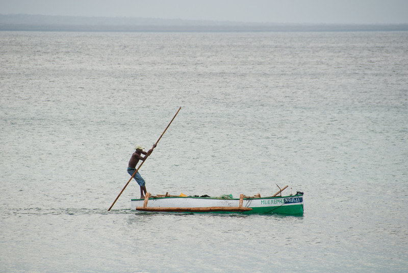 "<span id=""title"">Boater</span> A lot of locals cruised back and forth along the main beach in small canoes. As you can tell by this guys' method of movement, the water is very shallow."