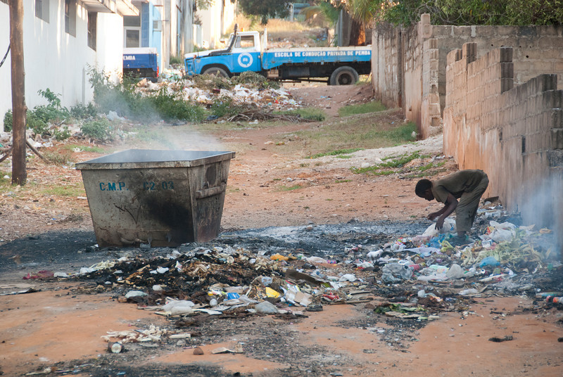 """<span id=""""title"""">Trash Management</span> Just a block from the main intersection of town, this person was going through the trash as it burned around them."""
