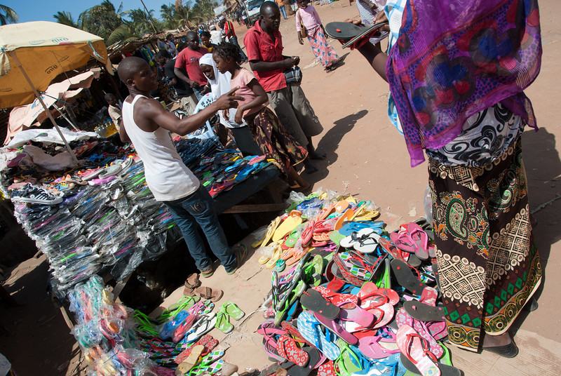 "<span id=""title"">Flip Flops</span> That's a big pile of flip flops for sale at Banguia market. The fact that everyone wears flip flops definitely adds to the laid-back beach-town atmosphere. However, the main reason is that flip flops are all most people can afford, even though it means replacing them every few months."