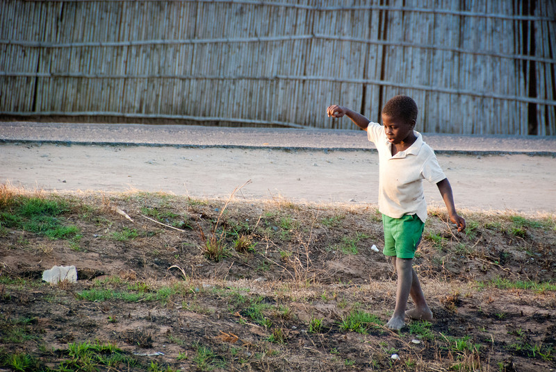 """<span id=""""title"""">Sunset Dance</span> As we got back from the center of town, kids were getting out of a nearby school. There was a lot of pointing and staring :) This kid looks like he was walking a tightrope or something. Crazy kids..."""