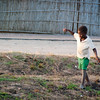"<span id=""title"">Sunset Dance</span> As we got back from the center of town, kids were getting out of a nearby school. There was a lot of pointing and staring :) This kid looks like he was walking a tightrope or something. Crazy kids..."