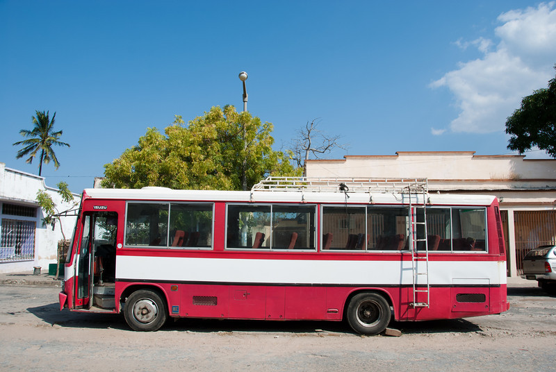 """<span id=""""title"""">Red Bus</span> Looks like a perfectly good bus... I wonder what it was for and why it was just sitting there."""