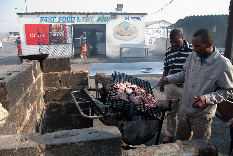 "<span id=""title"">Buy and Braai</span> <em>Soweto</em> After spending a week in Pemba, Mozambique, we flew back to Johannesburg and did some tours around the city and surrounding area. The first place we went was Soweto, and this is a particularly poor area near some very large slums. Braai is the South African word for barbeque. You buy your meat from the store in the back and then bring it out to grill it. This was very early in the morning and everyone was drinking beer. But hey, it was Sunday."