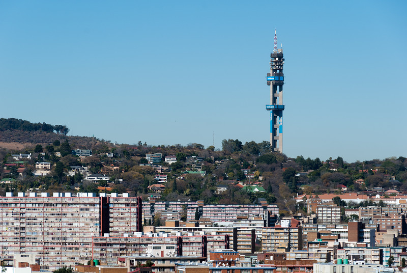 """<span id=""""title"""">Pretoria</span> <em>Pretoria</em> A view of South Africa's capital from the Union Buildings. The guest house we stayed in is one of those houses on the hill (or near them, anyways)."""