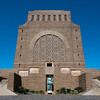 "<span id=""title"">In Full</span> <em>Voortrekker Monument, Pretoria</em> Here's an overall shot of the monument. The other three sides are pretty similar."