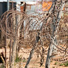 "<span id=""title"">Razor Wire</span> <em>Soweto</em> We saw a lot of this sort of fencing around Johannesburg. A LOT."