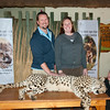 "<span id=""title"">Petting a Cheetah</span> <em>Ann van Dyk Cheetah Centre</em> Not only did we get to see three separate cheetahs run at full speed, then we got to pet one! This is one of their 'ambassador' cheetahs that they take to schools and events to promote awareness. The handler coaxed the cheetah onto the table with food, and then it just laid down and started purring - LOUDLY. I guess it really likes being petted. We were instructed only to pet between the shoulder and hip bone. Not scratching the ears or rubbing the belly allowed - not because the cheetah wouldn't enjoy it, but because if he twitched he could tear a giant gash in you."