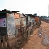 "<span id=""title"">Informal Settlement</span> <em>Soweto</em> I guess 'informal settlement' is a nice word for slums. We weren't exactly sure why our tour guide took us here, but it was an experience to see it. Each 'block' shares a single spigot for water. I'm not sure how sewage works. As you can see, homes are built mostly with scrap metal."