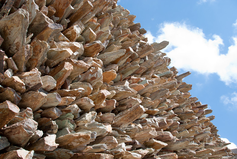 """<span id=""""title"""">Wall of Pointy Rocks</span> <em>Maropeng, Cradle of Humanity</em> Maropeng is designed so that you enter, go on a little 'ride' showing the creation of the world and then walk through the exhibits which are all in a cave-like elongated building. When you come out, you see this awesome wall of rocks. I struggled with how to take a good photo of it, but it was very striking in person."""