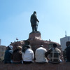 "<span id=""title"">Sitting</span> <em>Church Square, Pretoria</em> Lots of people were sitting around in Church Square. The statue is of Paul Kruger. He has a national park named after him that you might have heard of."