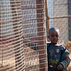 "<span id=""title"">Curious</span> <em>Soweto</em> This cute kid watched us from his yard."