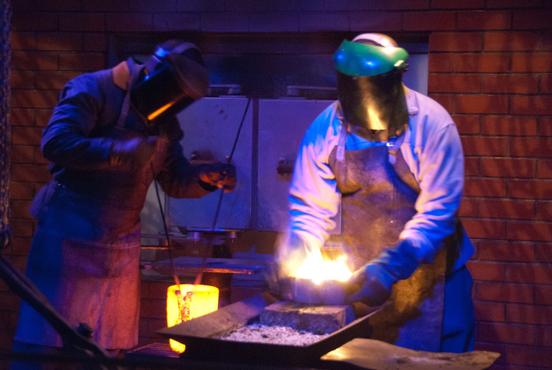 "<span id=""title"">Metal Management</span> <em>Gold Reef City, Johannesburg</em> Pouring liquid metal into a form is a 2-person job. I love how anonymous these guys look."