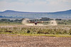 Landing on the dirt runway at Maasai Mara (Notice the wingtip voticies outlined in dust)