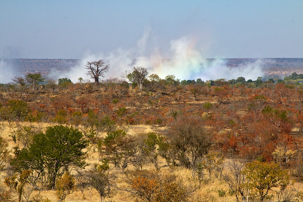 The spray from Victoria Falls in the distance