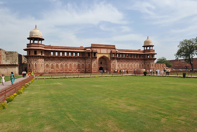 Jahangiri Mahal at Agra Fort, India.  Jahangiri Mahal (Hindi: जहाँगीरी महल, Urdu: جہانگیری محل), is the most prominent building inside the Agra Fort of India. The Mahal was the principal zenana (palace for women belonging to the royal household), and was used mainly by the Rajput wives of Akbar. The building is made of red sandstone. A splendid gateway leads to an interior courtyard surrounded by grand halls covered with profuse carvings on stone, heavily fashioned brackets, piers, and crossbeams. One can still spot remnants of decoration in gold and blue done in the prevalent Indo-Persian style.
