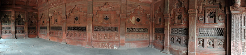 Panoramic view of decorated columns at Agra Fort (Lal Qila).  The Agra Fort is about 2.5 km northwest of the Taj Mahal. The fort can be more accurately described as a walled palatial city.