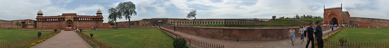 Panoramic view of Jahangiri Mahal at Agra Fort, India.  Jahangiri Mahal (Hindi: जहाँगीरी महल, Urdu: جہانگیری محل), is the most prominent building inside the Agra Fort of India. The Mahal was the principal zenana (palace for women belonging to the royal household), and was used mainly by the Rajput wives of Akbar. The building is made of red sandstone. A splendid gateway leads to an interior courtyard surrounded by grand halls covered with profuse carvings on stone, heavily fashioned brackets, piers, and crossbeams. One can still spot remnants of decoration in gold and blue done in the prevalent Indo-Persian style.