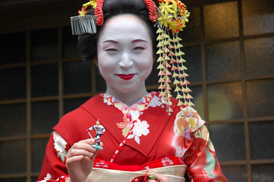 Kyoto, Japan... figurine treated right by a geisha