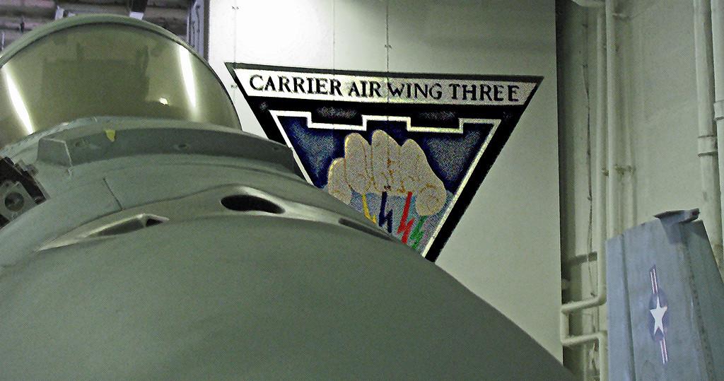 Carrier Air Wing Three Hangar Deck USS HST viewed over the nose of an F/A18 Fighter