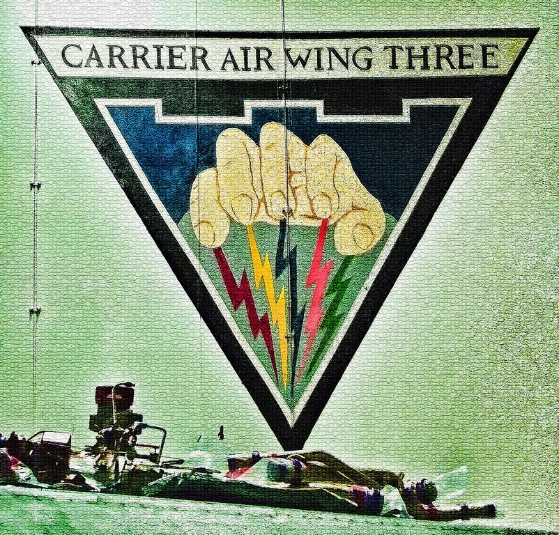 Carrier Air Wing Three (Battle Axe) Hangar USS Truman.  In January 2013, Captain Sara A. Joyner (Commander of Carrier Air Wing Three) became the first woman to command a Navy Carrier Air Wing.