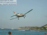 This is a private single engine plane taking off, and it doesn't clear the beach by more than a few feet.