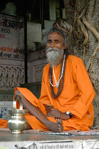 Old monk sitting near the steps of the Bhramha Temple in Pushkar.  The Brahma temple located in Pushkar, Rajasthan is one of the important Hindu pilgrim centre. It is just 10 km from Ajmer, Rajasthan.