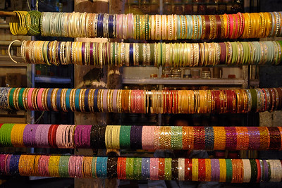 Bangles on display. The sites of the city of Pushkar. Shops selling assorted items. The city is famous for the Brahma temple located in Pushkar, Rajasthan. It is just 10 km from Ajmer, Rajasthan.