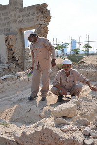 Archaeological team members working on the date cellar called a medbassa, located in the Sheikh's house.