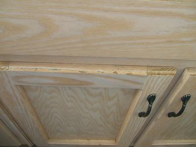 Kitchen cupboards below sink.