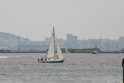 Sailboat with (I think) the San Francisco skyline in the distance.