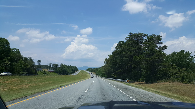 I always feel a happiness come over me when I see top this one hill on I-26W and you can see the mountains in the distance.