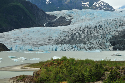 Mendenhall Glacier.  One can get a feel for the size of this glacier wall by viewing the previous photo and comparing it to this one.  Compare to previous Photo....The boat is behind the icebergs center left and the waterfall is to the far right of the glacier wall.