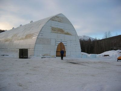 "Nancy at the Ice Hotel in Chena Hot Springs. The bumps on top are the light producers for the fiber optic chandeliers inside. The structure is a 16"" of styrofoam, air, and other insulators to help keep the inside at a toasty 20F."