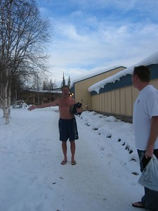 Larry walked home from the Hot Springs in his swim trunks. The Hot Springs is so warm the ice and snow feels good.