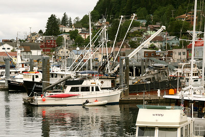 Small boat harbor next to cruise ship.