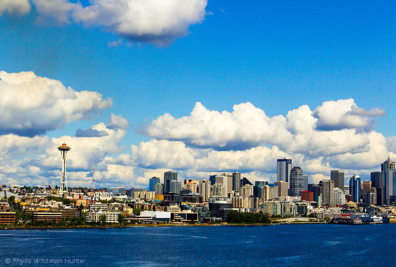 Convergence.  A skyline view of Seattle including the Space Needle.
