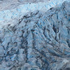 Close up of a glacier ice -  notice how blue it is.  The dirt is wash off from the mountains.