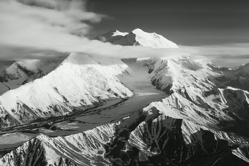 Denali (Mt. McKinley), east face.  South (left) and North (right) Peaks at top center.  Carpe and Pioneer ridges rise up to left and right respectively of Muldrow Glacier which sweeps down center of picture from the Harper Icefield.