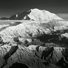 "Denali (""the great one""), tallest mountain in North America at over 20,000 feet.  Image taken from open door plane flying at an altitude of approximately 12-13 thousand feet.  This view is of the north-facing Wickersham Wall of the mountain."