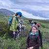 Elena graciously allowing me to snap a shot.  Liz (Elena's mom) is wearing the blue cap.  Mateo (red backpack) is our guide. Mitzi is inspecting some wildflower.  Laurie is at rear photographing us.