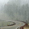 Snow falling on US64  between Taos and Chama, NM, 05/12/2014.