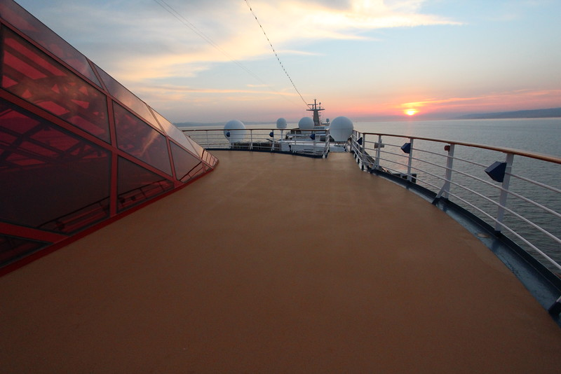 A sunset stroll looking from the back to the front of the ship.