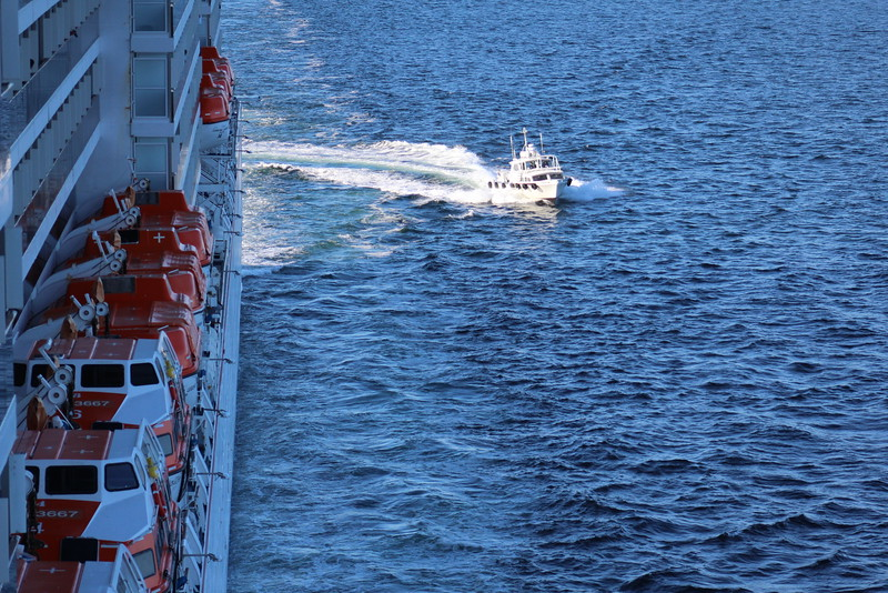 As we entered the narrowest part of the fjord, a pilot boat arrived to help us navigate.