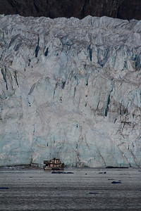 """Catalyst"" up close to Margerie Glacier. The glacier's face is 250 feet tall above the waterline."