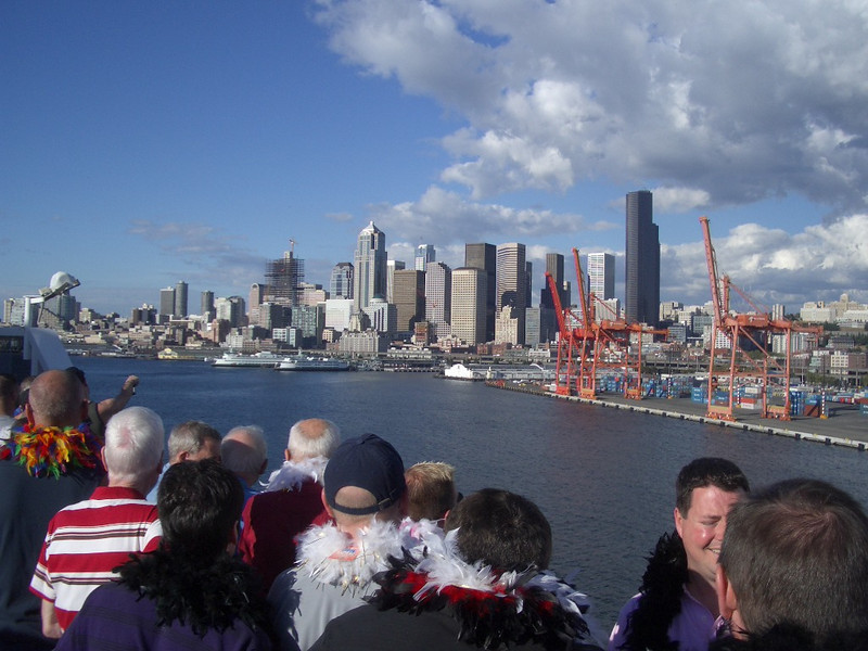 Day 1 - downtown Seattle, as seen from the deck of our ship as we set sail.  The feather boas were a bon voyage gift from the tour company.  Did we mention it was a gay cruise?
