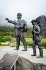 A guide and prospectors statue representing the relationship of the native to the crazy white folks.