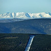 Beautiful Alaska mountains in the distance and a buried portion of the Alaska Pipeline in the foreground.