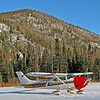 My friend's very immaculate Cessna 182 which served as our siteseeing platform for the area around Fairbanks, AK to Chena Hot Springs.  The red blanket on the nosecone is to keep the engine warm enough that it will restart without needing a lengthy preheat (which may not have been available there).