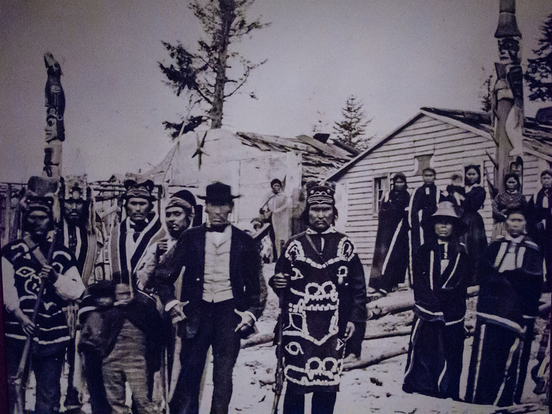 The first known photo of an Alaskan tribe with totem poles